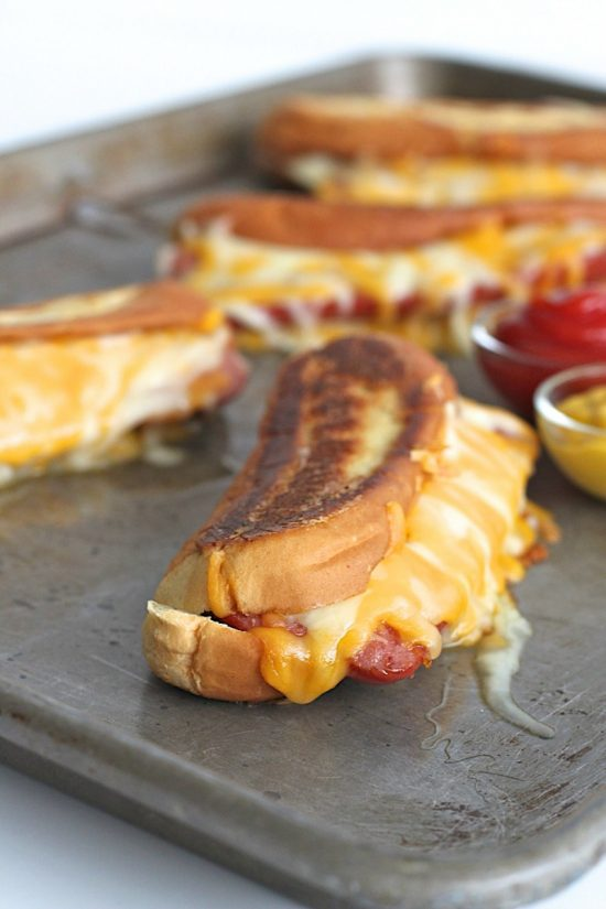 A brilliant combination of two classics: grilled cheese and hot dogs! A buttery crisp hot dog bun filled with lots of melted cheese and a juicy grilled hot dog. Why choose when you can have both?