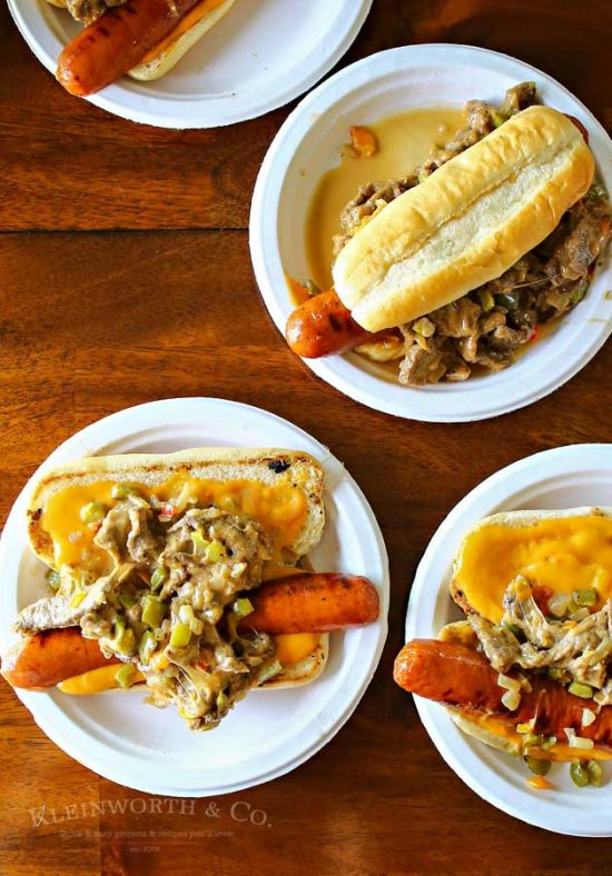The Philly Cheesesteak Hot Dog is a twist on two iconic food recipes. Combining grilled hot dogs & the best philly cheesesteak recipe is over the top amazing!