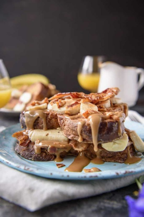 Elevate your breakfast with a batch of this incredible Elvis-Style Brioche French Toast! Fresh bananas, crispy bacon, and an easy peanut butter syrup turn an ordinary weekend breakfast into something super special!