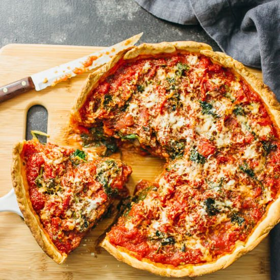 homemade Chicago-style deep dish pizza with spinach from scratch! The dough is easy to prepare and the filling can be made of your favorite pizza toppings.