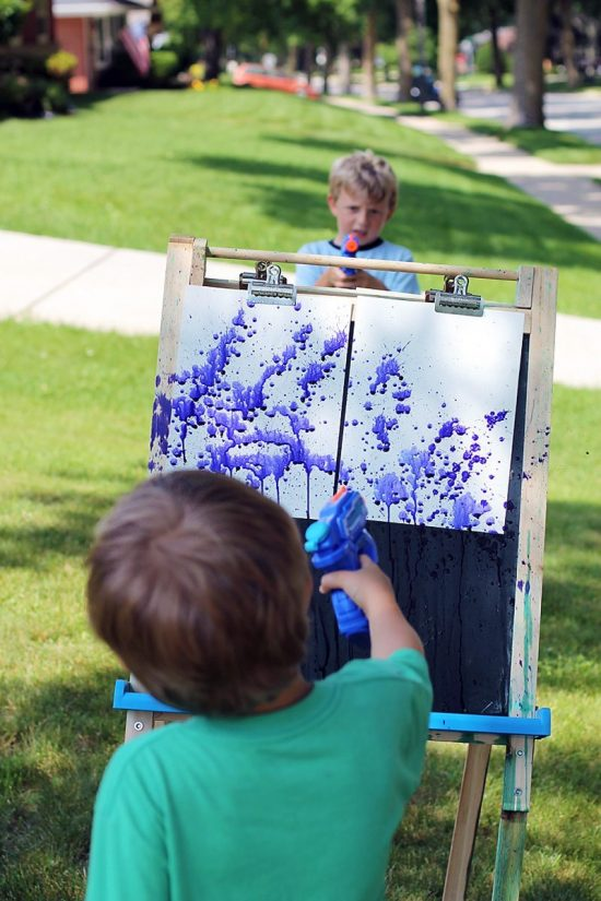 Squirt gun painting is a thrilling summer art experience for kids and the ultimate boredom buster!
