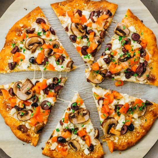 Follow this easy recipe to make a keto pizza crust that's grain free, using what's commonly referred to as fathead dough. The pizza is topped with low carb Greek style toppings.